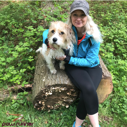 Running with your dog, a woman and a dog sat on a log