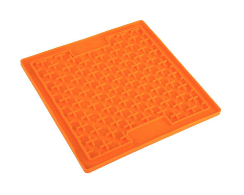 An orange mat with an intricate ridging. The mat is square and sits against a white background. A tool to stop dogs from eating too fast.