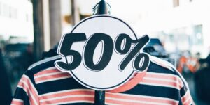 add a discount - an image of a sign with 50 percent off